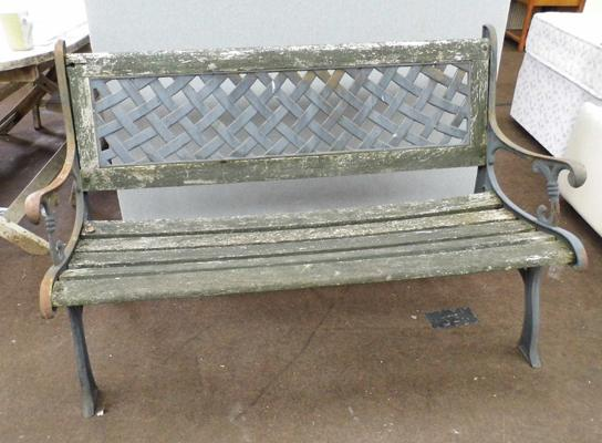 Cast garden bench with trellis back