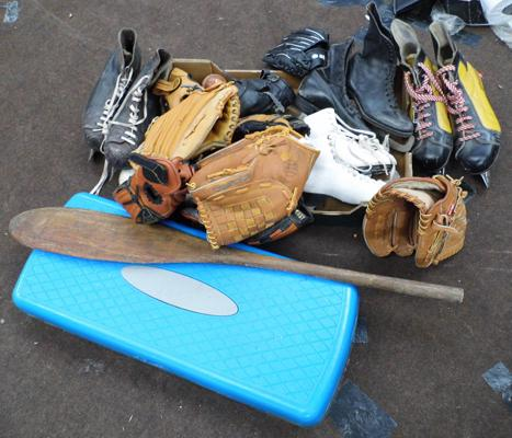 Box of sporting items inc vintage ice skates & baseball gloves